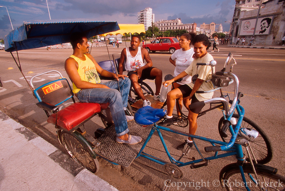 CUBA, HAVANA (HABANA VIEJA) Avenida Maceo, commonly called the Malecon, and Havana's famous seaside drive with parked pedicab drivers