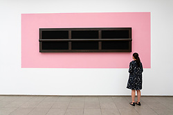Woman looking at painting Venezia (Venice), 1987 by Gerhard Merz at Hamburger Bahnhof art museum in Berlin, Germany. .Editorial Use Only.