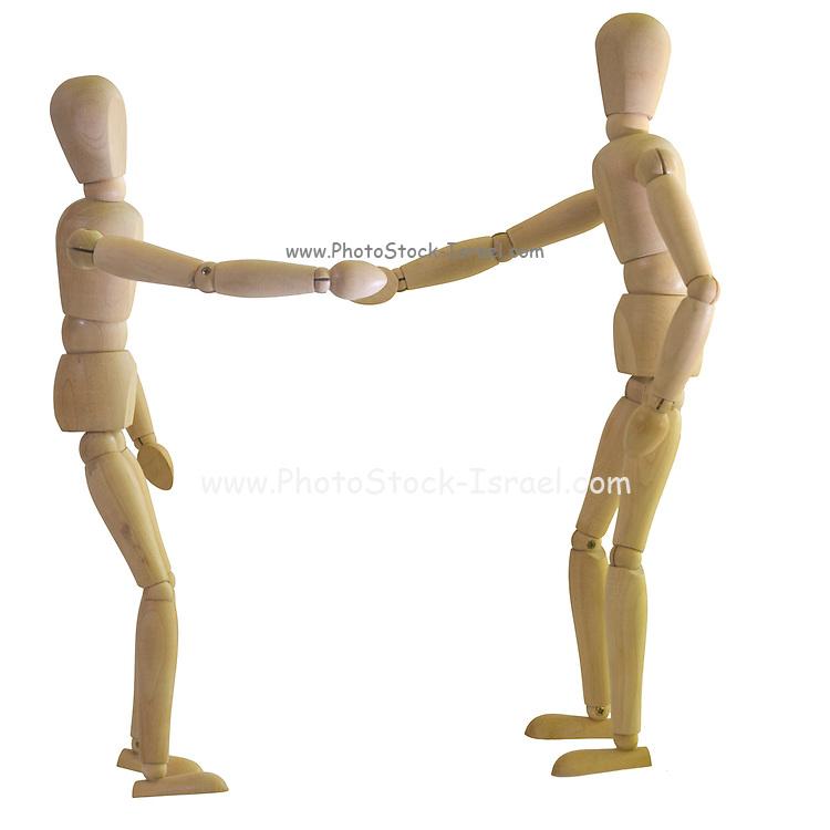 Posed artist manikin on white background shaking hands