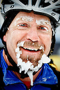 SHOT 2/9/13 12:22:49 PM - Todd Smith of Breckenridge, Co. flashes a smile and an ice-crusted goatee at the finish line of the Ski Mountaineering event at the second annual Winter Mountain Games presented by Eddie Bauer at Vail Ski Resort in Vail, Co. Smith finished second in the Advanced Male class in the event. The Winter Mountain Games feature competitions in X-Country On-Snow Mountain Bike Races, mixed climbing, Telemark Big Air, Best Trick Bike and On-Snow Mountain Bike Crit with more than $60,000 in prize money on the line. (Photo by Marc Piscotty / © 2013)