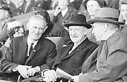 Mr. Alf Murray President GAA, President Eamonn DeValera and Taoiseach Sean Lemass enjoying the All Ireland Senior Gaelic Football final Kerry v. Galway in Croke Park on 27th September 1964.
