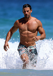 EXCLUSIVE: The Original Aussie Bachelor Tim Robards from the hit TV Show 'The Bachelor' goes swimming with a friend at Bondi Beach. 16 Oct 2017 Pictured: Tim Robards. Photo credit: Mega TheMegaAgency.com +1 888 505 6342