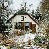 old farmhouse converted to a cozy house in a winter setting, Hoevelaken, the Netherlands