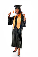 Portrait of young girl graduating, very happy, thumbs up.