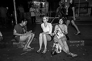 Two young women traveling in Thailand sit for caricature sketches on Khao San Road in Bangkok. (November 19, 2011)