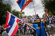 18 FEBRUARY 2014 - BANGKOK, THAILAND:  Anti-government protestors in Bangkok confront Thai riot police near Government House. Anti-government protestors aligned with Suthep Thaugsuban and the People's Democratic Reform Committee (PDRC) clashed with police Tuesday. Protestors opened fire on police with at rifles and handguns. Police returned fire with live ammunition and rubber bullets. The Bangkok Metropolitan Administration's Erawan Emergency Medical Centre reported that three civilians and a policeman were killed and 64 others were injured in the clashes between police and protesters.   PHOTO BY JACK KURTZ
