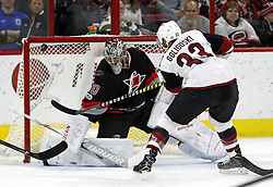March 3, 2017 - Raleigh, NC, USA - The Arizona Coyotes' Alex Goligoski (33) goes top shelf to score against the Canes Cam Ward (30) during the first period of an NHL game played between the Carolina Hurricanes and the Arizona Coyotes at PNC Arena on March 3, 2017 in Raleigh, N.C. (Credit Image: © Chris Seward/TNS via ZUMA Wire)