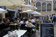 Street tapas cafe tables outside central market building, city of Valencia, Spain