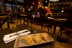 Tortilla de patatas (egg and potato pie), accompanied by housemade sangria, at La Marchas Tapas Bar, Wednesday, Jan. 13, 2016, in Berkeley, Calif. (Photo by D. Ross Cameron)