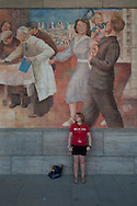 n the outdoor courtyard of the old Ministry of Aviation of the GDR, today the german Ministry of Finance, a mural in typical Socialist Realism style has been preserved.