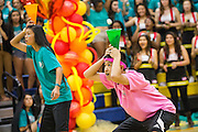 Milpitas High School sophomores catch a marshmallow in a cone during the Marshmallow Toss contest during the annual Trojan Olympics, where students compete in various unorthodox events for class bragging rights, at Milpitas High School in Milpitas, California, on March 27, 2015. (Stan Olszewski/SOSKIphoto)