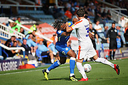 Peterborough United forward Ivan Toney (17) gets a forearm in the face from Luton Town defender Dan Potts (3) during the EFL Sky Bet League 1 match between Peterborough United and Luton Town at London Road, Peterborough, England on 18 August 2018.