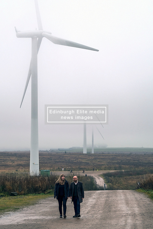 Patrick Harvie, Monday 2nd December 2019<br /> <br /> Pictured: Scottish Greens Co-Leader Patrick Harvie MSP visits the UK's largest onshore windfarm where he called for the devolution of energy policy to help Scotland tackle the climate crisis. The Scottish Greens candidate for Falkirk Gillian MacKay joins him as he looks around.<br /> <br /> Alex Todd   Edinburgh Elite media