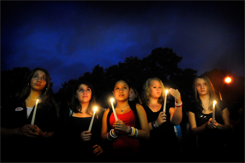 """Sayreville High School students hold up their respective candles during a candle light vigil held by Students Against Destructive Decisions (SADD) at Sayreville War Memorial High School on October 27, 2010.  The SADD Chapter at Sayreville High School held the event in remembrance of victims of alcohol and drug abuse. The event is also part of activities for """"Red Ribbon Week,"""" which calls attention to the dangers of alcohol and drug abuse."""