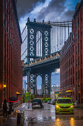 The Manhattan Bridge is a suspension bridge that crosses the East River in New York City, connecting Lower Manhattan (at Canal Street) with Brooklyn (at Flatbush Avenue Extension). It was the last of the three suspension bridges built across the lower East River, following the Brooklyn and the Williamsburg bridges.