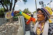 01 DECEMBER 2013 - BANGKOK, THAILAND: A Thai anti-government protestor screams at Thai riot police in Bangkok. Thousands of anti-government Thais confronted riot police at Phanitchayakan Intersection, where Rama I and Phitsanoluk Roads intersect, next to Government House (the office of the Prime Minister). Protestors threw rocks, cherry bombs, small explosives and Molotov cocktails at police who responded with waves of tear gas and chemical dispersal weapons. At least four people were killed at a university in suburban Bangkok when gangs of pro-government and anti-government demonstrators clashed. This is the most serious political violence in Thailand since 2010.    PHOTO BY JACK KURTZ