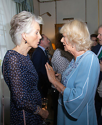 Her Royal Highness Camilla the Duchess of Cornwall hosts a reception at Clarence House to mark the tenth anniversary of First story, an initiative to encourage writing in especially among those from deprived backgrounds in schools across the country PICTURED: Joanna Trollope and Camilla chat during the reception . London, July 10 2018.