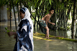August 16, 2017 - Dhaka, Dhaka, Bangladesh - August 16, 2017 Bogra, Bangladesh - A boy with banana boat moves to other place for continuous flooding in Sariakandhi. Peoples' suffering continues as many of them left their homes along with their cattle, goats, hens and other pets and took shelter in safe areas and many of these people have still not been able to return as water has not fully receded from their homes. Flood-related incidents in Dinajpur, Gaibandha and Lalmonirhat raising the death toll to 30 in the last three days across the country. (Credit Image: © K M Asad via ZUMA Wire)