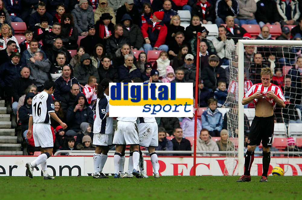 Photo: Andrew Unwin.<br /> Sunderland v Tottenham Hotspur. The Barclays Premiership. 12/02/2006.<br /> Tottenham's Robbie Keane (C) is mobbed by his team-mates after scoring his first goal.