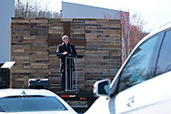 Pastor Kevin Fetterfhoff speaks from in front of the screen during Bethany Wesleyan Church's Sunday worship service Mar. 22, 2020, at Becky's Drive-In in Walnutport, Pennsylvania. Concerns over the coronavirus have closed churches in an effort to avoid gatherings of large crowds.