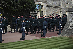 Members of RAF line the route of the procession as members of the Rifles march past at Windsor Castle, Berkshire, ahead of the funeral of the Duke of Edinburgh. Picture date: Saturday April 17, 2021.