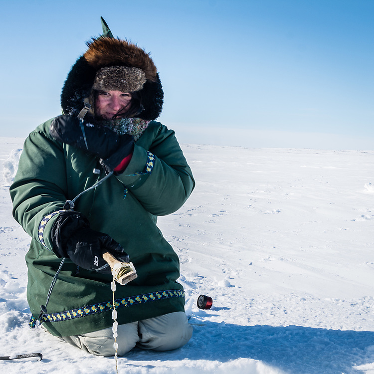Anne-Marie on her first fishing experience, is wearing a warm inuk parka.