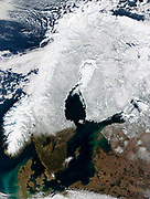 Scandinavia photographed in winter from a satellite orbiting the earth