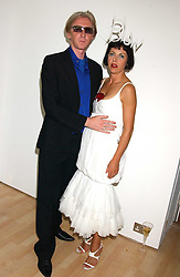 Milliner PHILIP TREACY and ISABELLA BLOW at the launch of 'Blow Lips' a new lipstick by Isabella Blow and MAC Makeup held at the the Blow de la Barra Gallery, 35 Heddon Street, London on 7th September 2005.<br /><br />NON EXCLUSIVE - WORLD RIGHTS