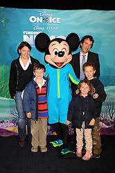 """THOMAS WHITAKER and family photographed with Mickey Mouse at a VIP Opening night of Disney & Pixar's """"Finding Nemo on Ice"""" at The O2 Arena Grennwich London on 23rd October 2008."""