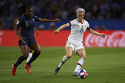 June 28, 2019 - Paris, France - Megan Rapinoe (Reign FC) of United States and Kadidiatou Diani (Paris Saint-Germain FC) of France competes for the ball during the 2019 FIFA Women's World Cup France Quarter Final match between France and USA at Parc des Princes on June 28, 2019 in Paris, France. (Credit Image: © Jose Breton/NurPhoto via ZUMA Press)