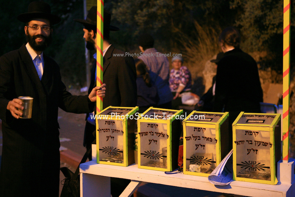 Israel, Mount Meron, Charity boxes at the Hillula (a celebration day) for Rabbi Simeon bar Yohai at Lag Baomer in Meron mountain, near Tzefat, the burial place of Rabbi Simeon bar Yochai and his son, Rabbi Eleazar ben Simon. hundred of thousands of people come each year to celebrate with lighting fires, candles, singing and feasting. On May 22, 2008.