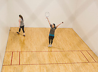 Mikenzie Watson and Hillary Stanley enjoy a game of racquetball on the court at Laconia Community Center Wednesday afternoon.  (Karen Bobotas/for the Laconia Daily Sun)