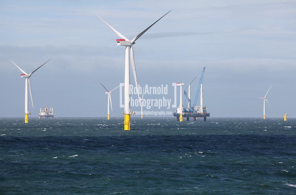 18/03/2014. Gwnt y Mor Wind Farm, North Wales, UK. A view of Seajack on the Gwynt y Mor Offshore Wind Farm installing a wind turbine. Photo credit : Rob Arnold