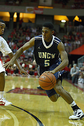 03 December 2011:  Adam Smith ties the baseline at the corner during an NCAA mens basketball game where the University of North Carolina at Wilmington Seahawks defeated the Illinois State Redbirds 63-54 inside Redbird Arena, Normal IL
