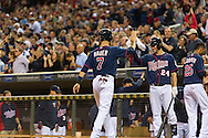Joe Mauer #7 of the Minnesota Twins is congratulated by his teammates after scoring against the Chicago White Sox on May 13, 2013 at Target Field in Minneapolis, Minnesota.  The Twins defeated the White Sox 10 to 3.  Photo: Ben Krause