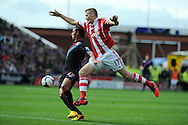 Stoke city's Ryan Shawcross ® attempts to block Marouane Chamakh of Crystal Palace but the Palace man breaks through  to score the 1st goal.Barclays Premier league match, Stoke city v Crystal Palace at the Britannia Stadium in Stoke on Trent on Saturday 24th August 2013. pic by Andrew Orchard , Andrew Orchard sports photography,