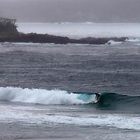USA, California, Carmel by the Sea. Surfer at Carmel Beach.