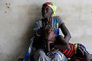 A woman comforts her son suffering from malaria as they wait for treatment at a Medicine Sans Frontieres (MSF) run clinic in the village of Likuangole, in Boma state, east of South Sudan, February 1, 2017. Picture taken on February 1, 2017. REUTERS/Siegfried Modola