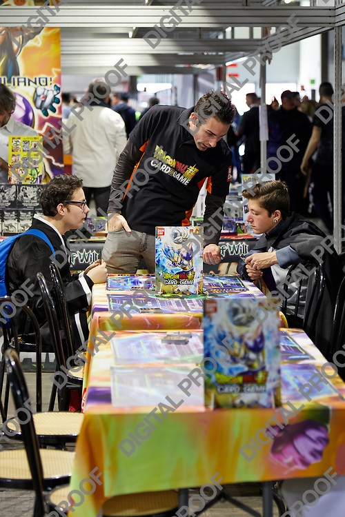 Milan, Italy - March 8 2019 Cartoomics Comic Con Dragon Ball Card Game tables with visitors playing