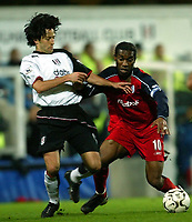 Photo. Aidan Ellis.<br />Fulham v Bolton Wanderers.<br />FA Barclaycard Premiership.<br />6/12/2003.<br />Fulham's Jerome Bonnissel and Bolton's Jay-Jay Okocha