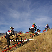 Dayle McLaughlin (left) and Tim Mulliner (centre) tackle the course during the New Zealand Cyclocross Championships sponsored by AJ Hackett Bungy, held at Jardine Park,  Queenstown, as part of the Queenstown WInter Festival. The men's event was won by Dan Warren from Hastings while Anja McDonald from Dunedin won the women's event. Queenstown, New Zealand, 2nd July 2011