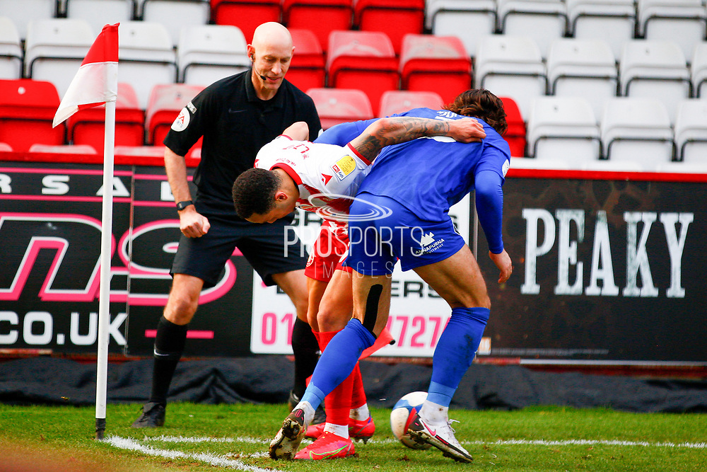 Dan Jones of Hqarrogate Town and of Stevenage tackle at the corner during the EFL Sky Bet League 2 match between Stevenage and Harrogate Town at the Lamex Stadium, Stevenage, England on 6 March 2021.