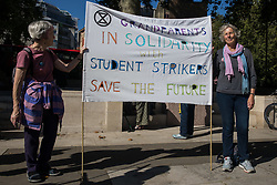 Grandparents hold a banner in Parliament Square in solidarity with hundreds of young people taking part in a Global Climate Strike to demand intersectional climate justice on 24th September 2021 in London, United Kingdom. The Global Climate Strike was organised to highlight the detrimental influences through colonialism, imperialism and exploitation of the Global North on MAPA (Most Affected Peoples and Areas), which have contributed to them now experiencing the worst impacts of the climate crisis, and to call on the Global North to pay reparations to MAPA.
