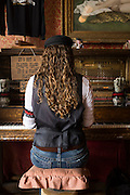 Lacy Black plays the paiano for tips at a local saloon in historic Silverton, Colorado.