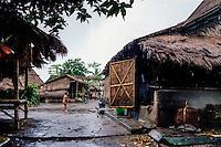 Nusa Tenggara, Lombok, Sade. Sade village. A sasak child playing in the rain.