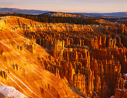 Bryce Amphitheater basking in warm light of sunrise, view from Inspiration Point, Bryce Canyon National Park, Utah.