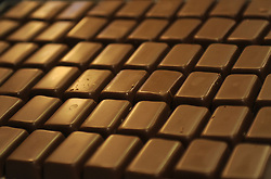 File photo dated 10/04/13 of chocolate bars. People who regularly eat chocolate may have a lower risk of developing an irregular heartbeat, a new study has found.