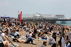 © Licensed to London News Pictures. 30/05/2021. Brighton, UK. Thousands of sun-seekers flock to the Brighton seafront on the hottest day of the year so far. According to the Met Office, a high of 24 degrees celsius is forecast for the bank holiday weekend, after weeks of rain in the South East of England. <br /> Photo credit: Dinendra Haria/LNP