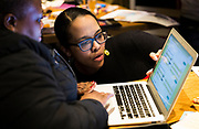 Ali Muldrow looks at early election results at the Madison School Board election watch party at Robinia Courtyard in Madison, Wisconsin, Tuesday, Feb. 19, 2019.
