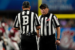 Officials speak to each other during the 2019 College Football Playoff Semifinal at the Chick-fil-A Peach Bowl on Saturday, Dec. 28, in Atlanta. (Paul Abell via Abell Images for the Chick-fil-A Peach Bowl)